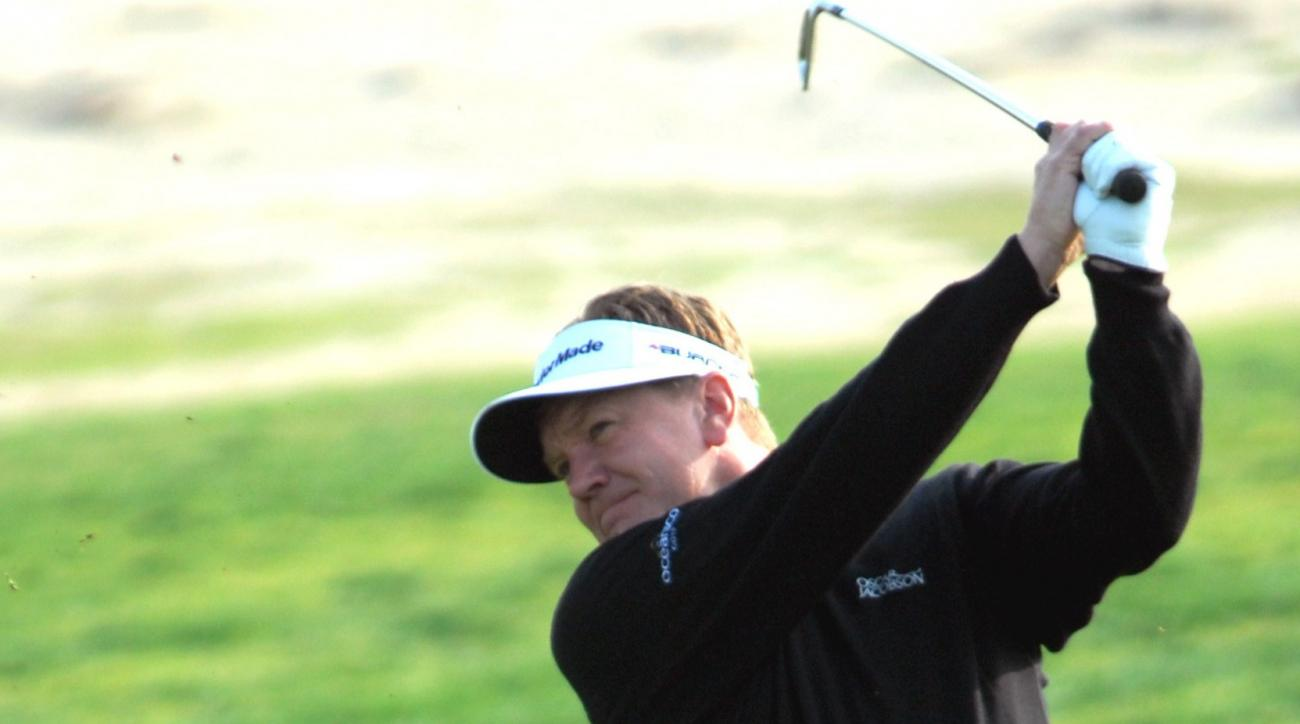 Britain's Paul Broadhurst plays a shot  on the  6th hole during the first round of the Qatar Masters Golf Tournament in Doha on Thursday Jan. 24,  2008. (AP Photo/Abdul Basit)