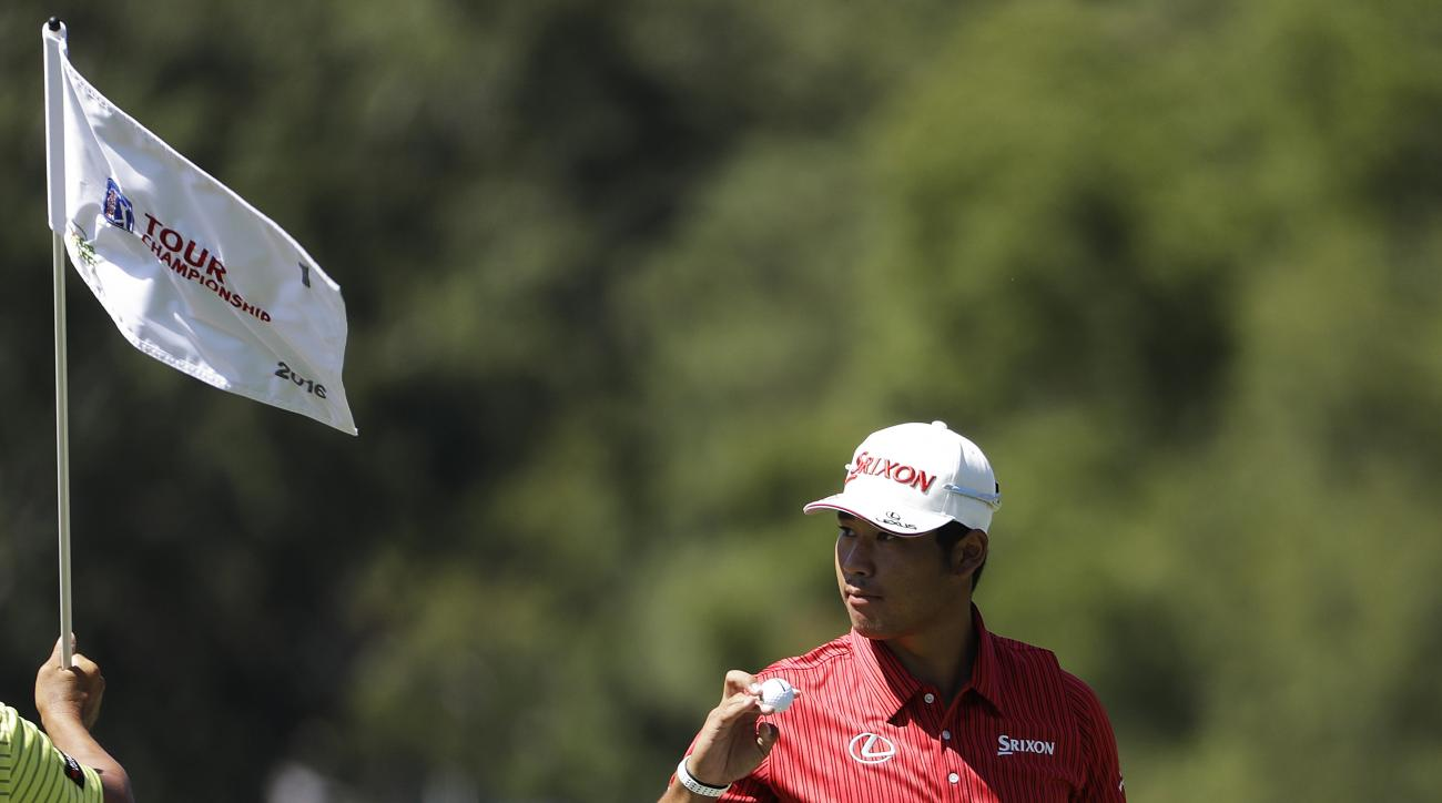 Hideki Matsuyama, of Japan, acknowledges the applause of the gallery after putting on the first hole during the first round of the Tour Championship golf tournament at East Lake Golf Club in Atlanta, Thursday, Sept. 22, 2016. (AP Photo/David Goldman)