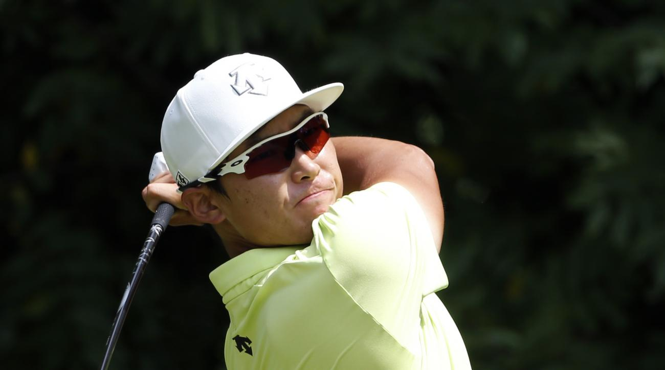 Whee Kim, of South Korea, watches his tee shot on the second hole during the final round of the John Deere Classic golf tournament Sunday, Aug. 14, 2016, in Silvis, Ill. (AP Photo/Nam Y. Huh)