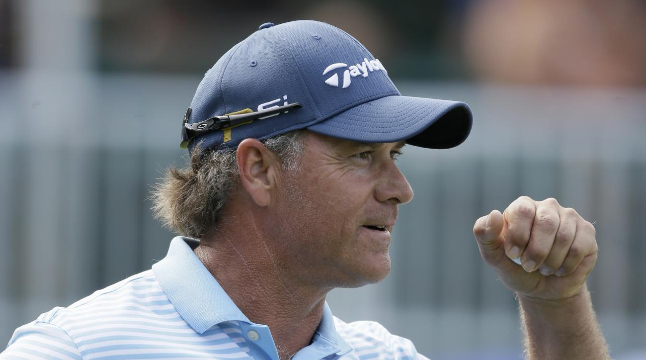 Scott McCarron reacts after his birdie putt on the 17th green during the final round of the PGA Tour Champions Principal Charity Classic golf tournament, Sunday, June 5, 2016, in Des Moines, Iowa. McCarron won the tournament. (AP Photo/Charlie Neibergall)