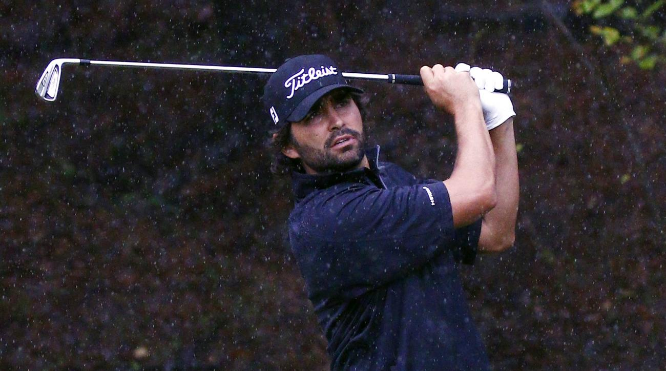 Martin Flores watches watches tee shot on the 10th hole during the continuation of Friday's second round of the Sanderson Farms Classic golf tournament, Saturday, Nov. 7, 2015, in Jackson, Miss. Friday's action was called because of weather and darkness w