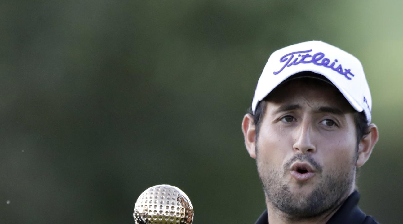 Alexander Levy of France lifts the trophy after winning the final round at the Porsche European Open at the Golf Resort in Bad Griesbach near Passau, Germany, Sunday, Sept. 25, 2016. (AP Photo/Matthias Schrader)