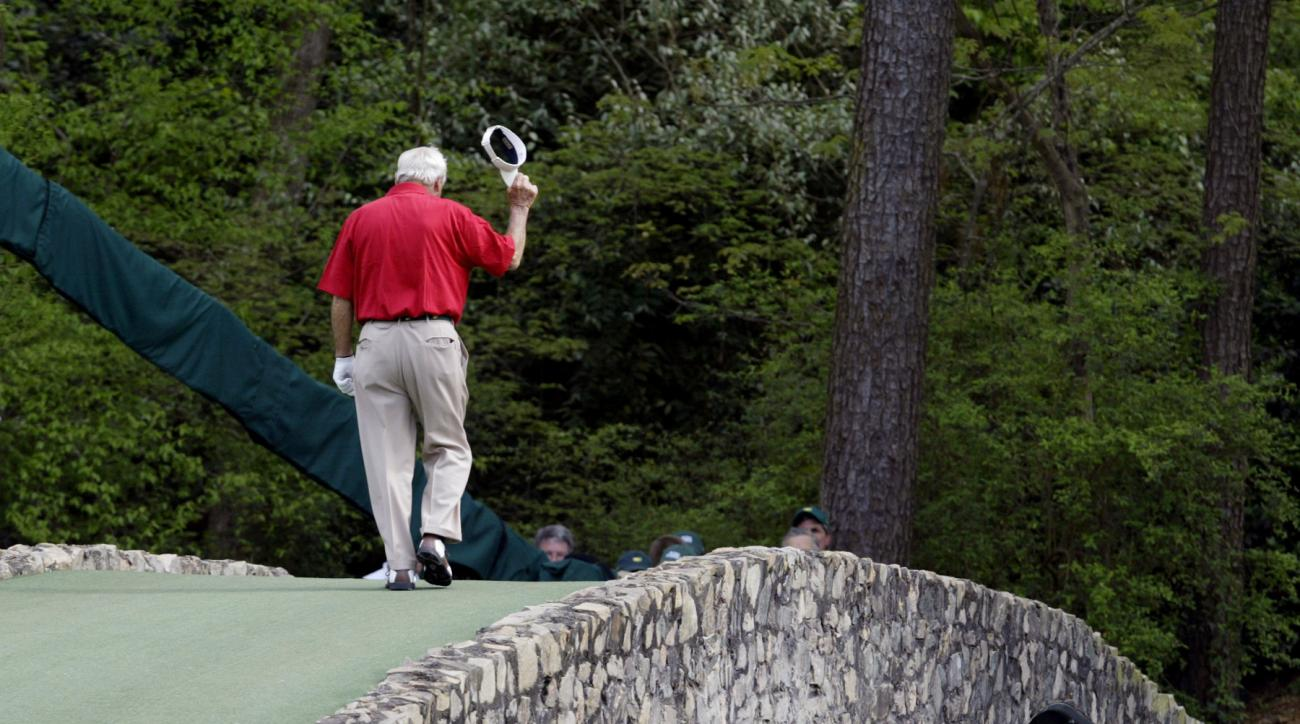 File- This April 9, 2004, file photo shows Arnold Palmer walking across the Hogan Bridge on the 12th fairway for the final time in Masters competition during the second round of the Masters golf tournament at the Augusta National Golf Club in Augusta, Ga.