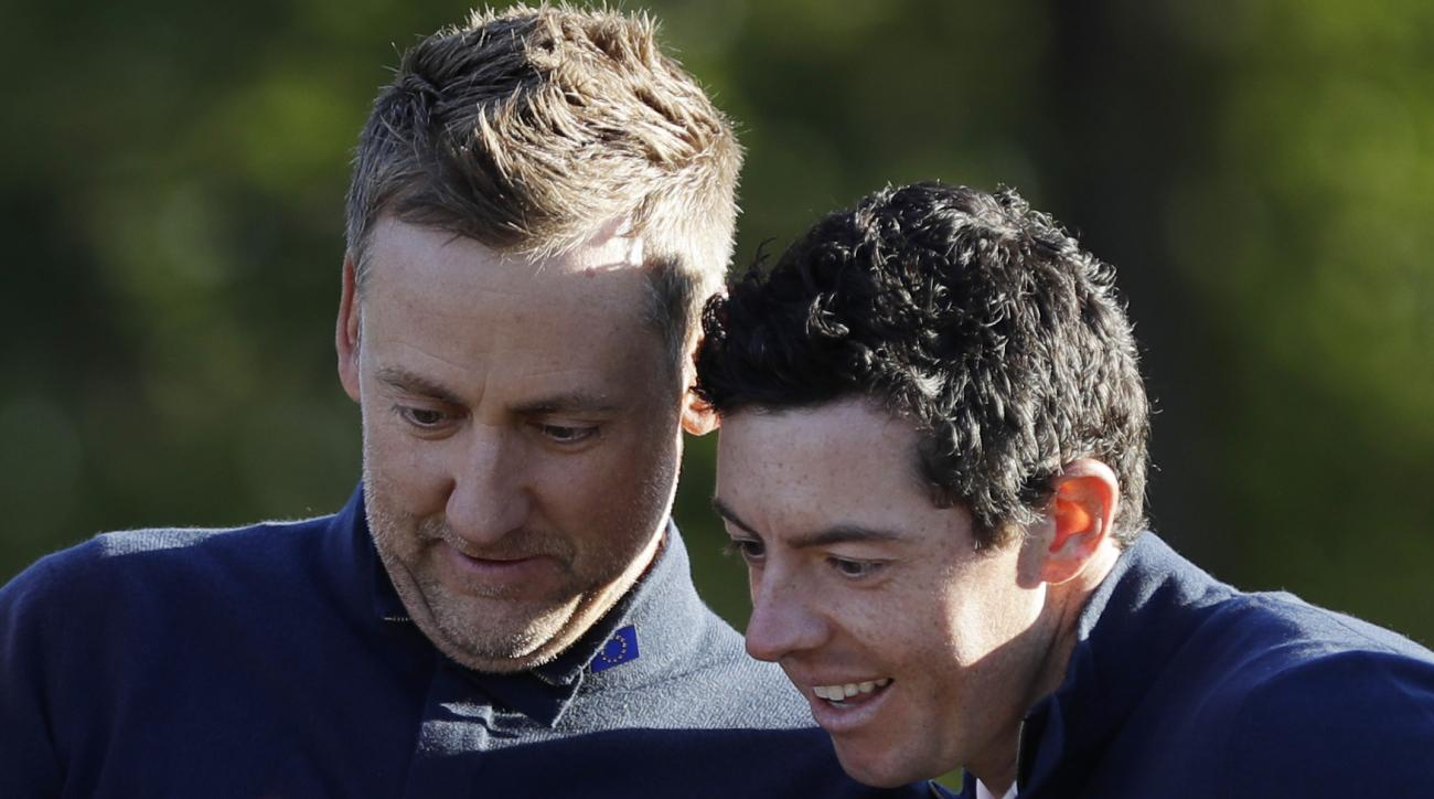 Europe's Rory McIlroy looks at Europe vice-captain Ian Poulter's phone before a practice round for the Ryder Cup golf tournament Tuesday, Sept. 27, 2016, at Hazeltine National Golf Club in Chaska, Minn. (AP Photo/David J. Phillip)