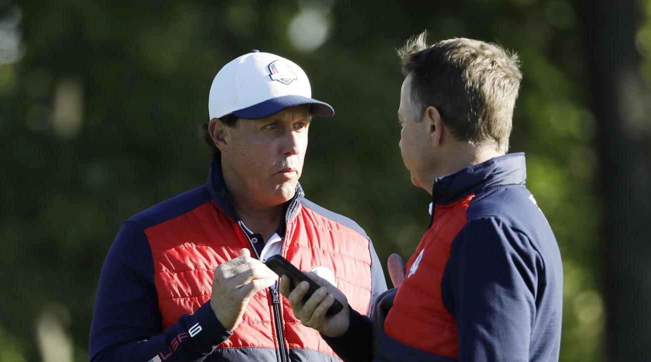 United States' Phil Mickelson talks to United States captain Davis Love III before a practice round for the Ryder Cup golf tournament Tuesday, Sept. 27, 2016, at Hazeltine National Golf Club in Chaska, Minn. (AP Photo/David J. Phillip)