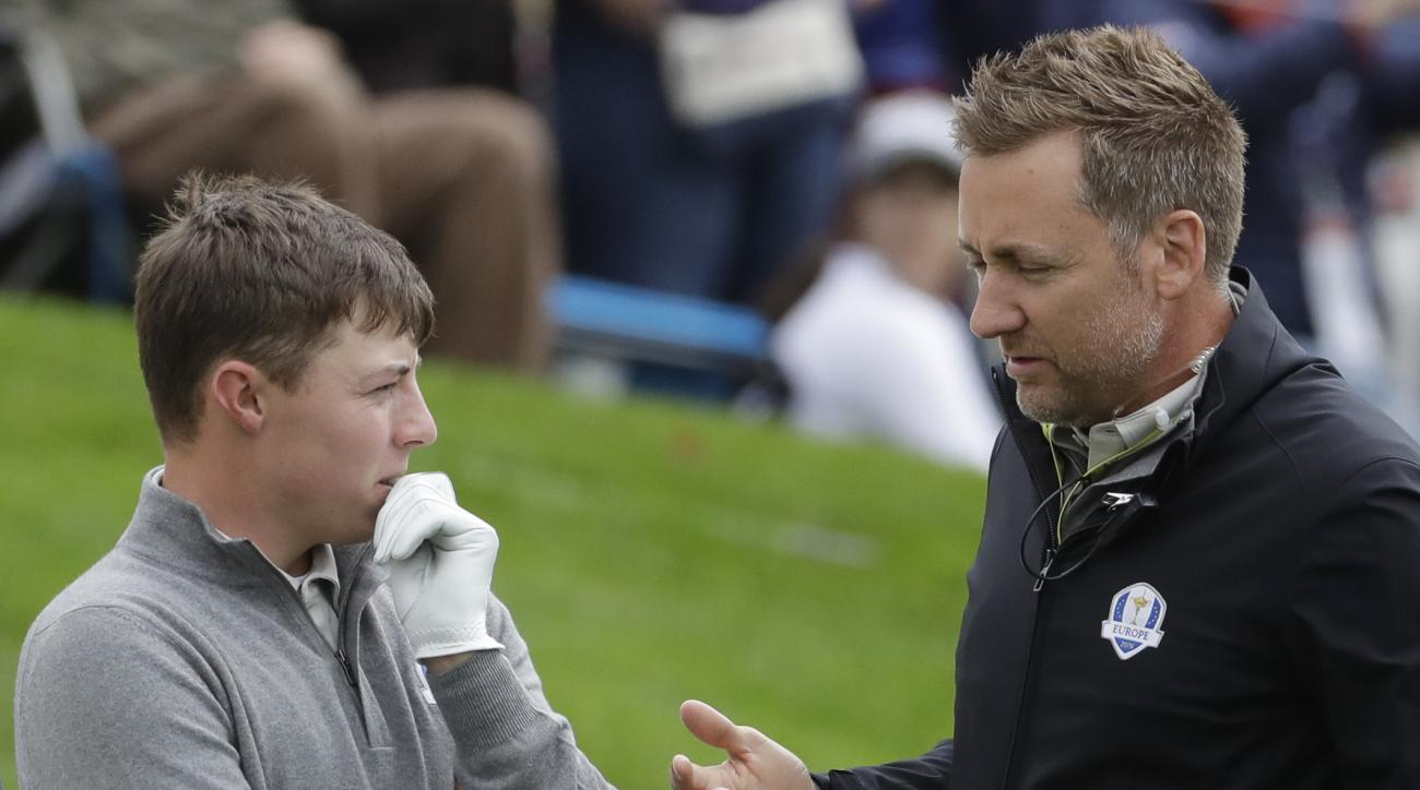 Europe vice-captain Ian Poulter talks to Europe's Matthew Fitzpatrick during a practice round for the Ryder Cup golf tournament Wednesday, Sept. 28, 2016, at Hazeltine National Golf Club in Chaska, Minn. (AP Photo/Chris Carlson)