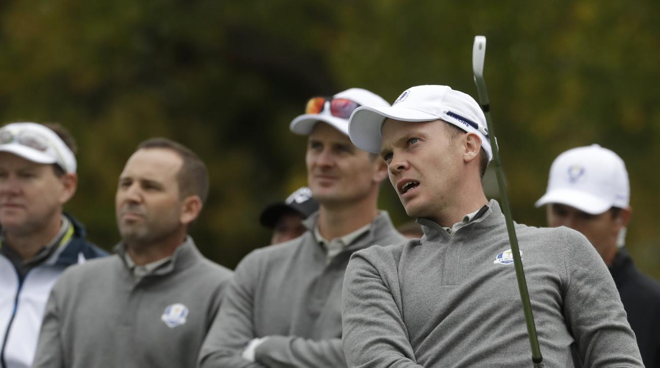 Europe's Danny Willett watches his drive with teammate Europe's Justin Rose and Europe's Sergio Garcia during a practice round for the Ryder Cup golf tournament Wednesday, Sept. 28, 2016, at Hazeltine National Golf Club in Chaska, Minn. (AP Photo/Chris Ca