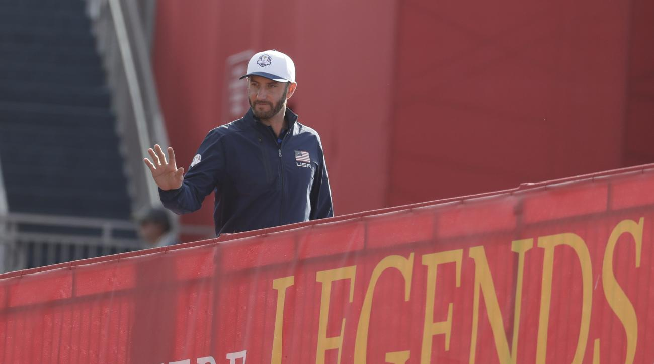 United States' Dustin Johnson walks to the range before a practice round for the Ryder Cup golf tournament Thursday, Sept. 29, 2016, at Hazeltine National Golf Club in Chaska, Minn. (AP Photo/Chris Carlson)