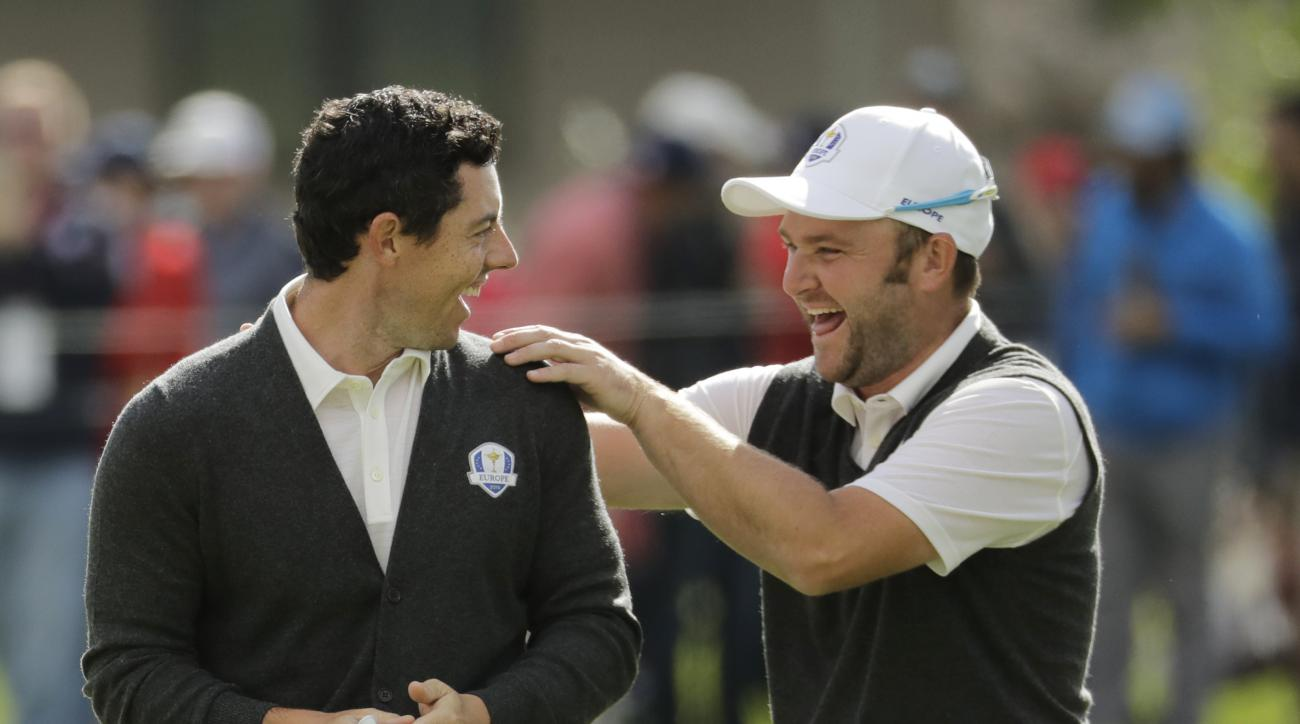 Europe's Andy Sullivan congratulates Europe's Rory McIlroy after McIlroy holed his approach shot on the sixth hole during a practice round for the Ryder Cup golf tournament Thursday, Sept. 29, 2016, at Hazeltine National Golf Club in Chaska, Minn. (AP Pho