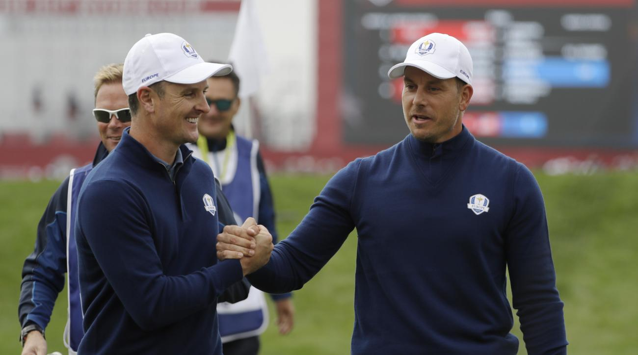 Europes Henrik Stenson and Europes Justin Rose celebrate after winning the ninth hole during a foresomes match at the Ryder Cup golf tournament Friday, Sept. 30, 2016, at Hazeltine National Golf Club in Chaska, Minn. (AP Photo/David J. Phillip)