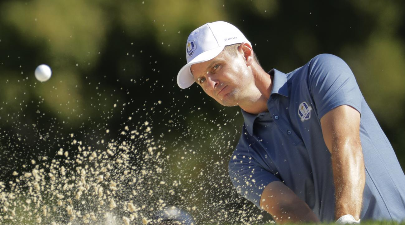 Europes Justin Rose hits from a bunker during a four-balls match at the Ryder Cup golf tournament Friday, Sept. 30, 2016, at Hazeltine National Golf Club in Chaska, Minn. (AP Photo/Charlie Riedel)
