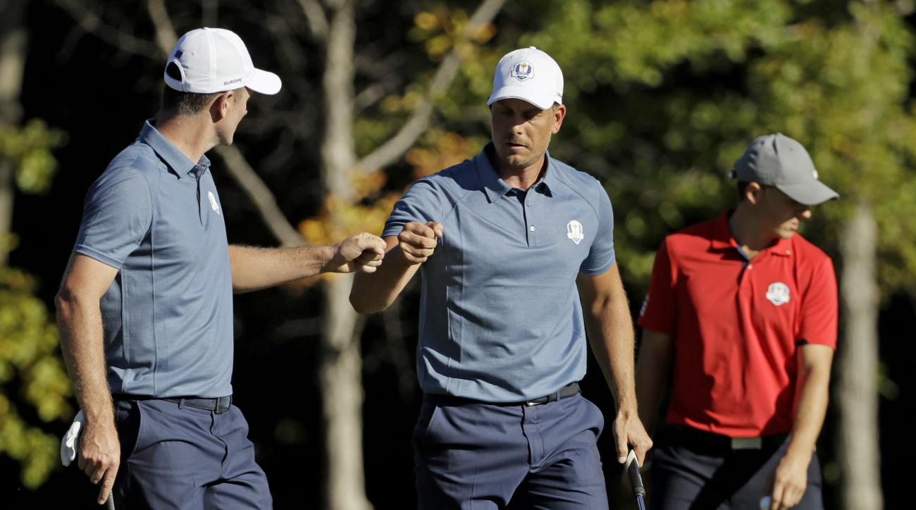 Europes Justin Rose congratulated Europes Henrik Stenson after a birdie on the 14th hole during a four-balls match at the Ryder Cup golf tournament Friday, Sept. 30, 2016, at Hazeltine National Golf Club in Chaska, Minn. (AP Photo/David J. Phillip)