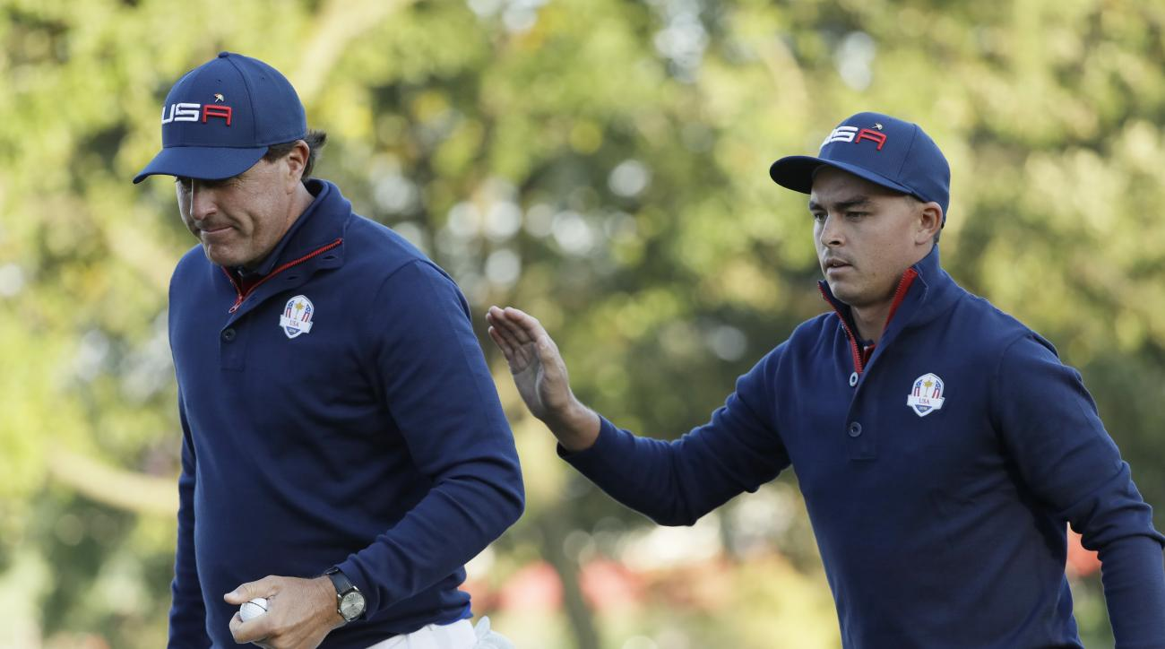 United States Rickie Fowler and United States Phil Mickelson walk off the third hole during a foresomes match at the Ryder Cup golf tournament Saturday, Oct. 1, 2016, at Hazeltine National Golf Club in Chaska, Minn. (AP Photo/David J. Phillip)