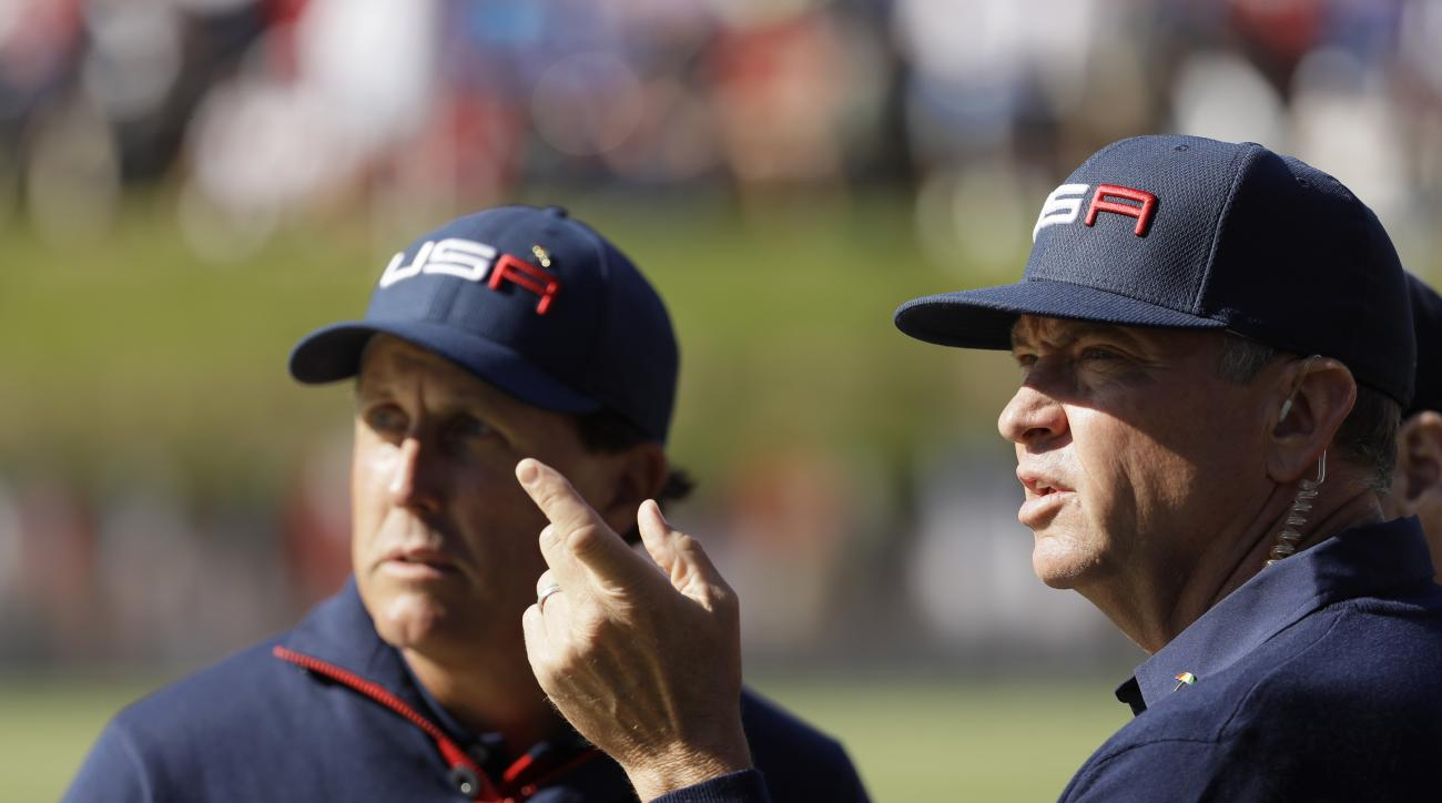 United States captain Davis Love III talks to United States Phil Mickelson on the 16th hole during a foresomes match at the Ryder Cup golf tournament Saturday, Oct. 1, 2016, at Hazeltine National Golf Club in Chaska, Minn. (AP Photo/David J. Phillip)
