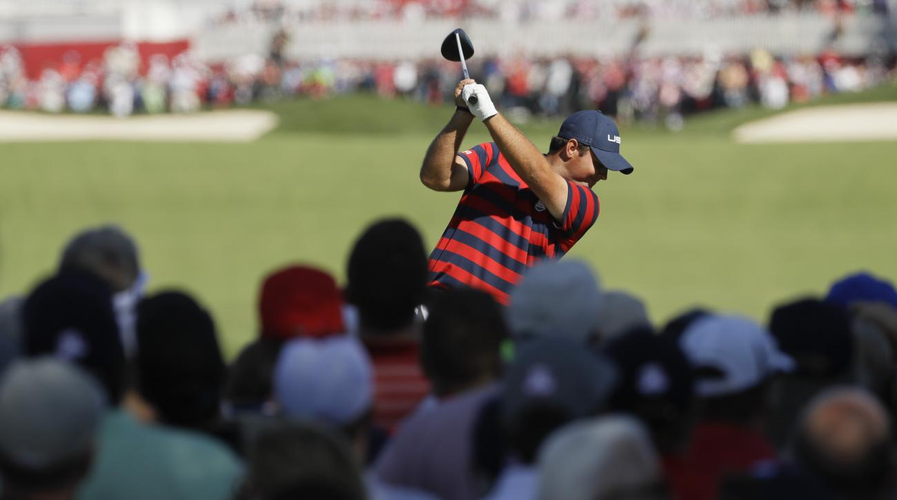 United States Patrick Reed hits a drive on the second hole during a four-ball match at the Ryder Cup golf tournament Saturday, Oct. 1, 2016, at Hazeltine National Golf Club in Chaska, Minn. (AP Photo/David J. Phillip)