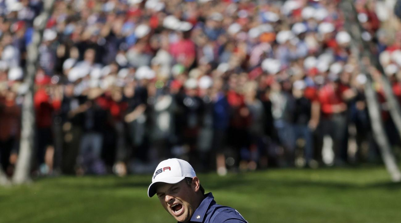 United States Patrick Reed reacts after saving par on the first hole during a singles match at the Ryder Cup golf tournament Sunday, Oct. 2, 2016, at Hazeltine National Golf Club in Chaska, Minn. (AP Photo/Chris Carlson)
