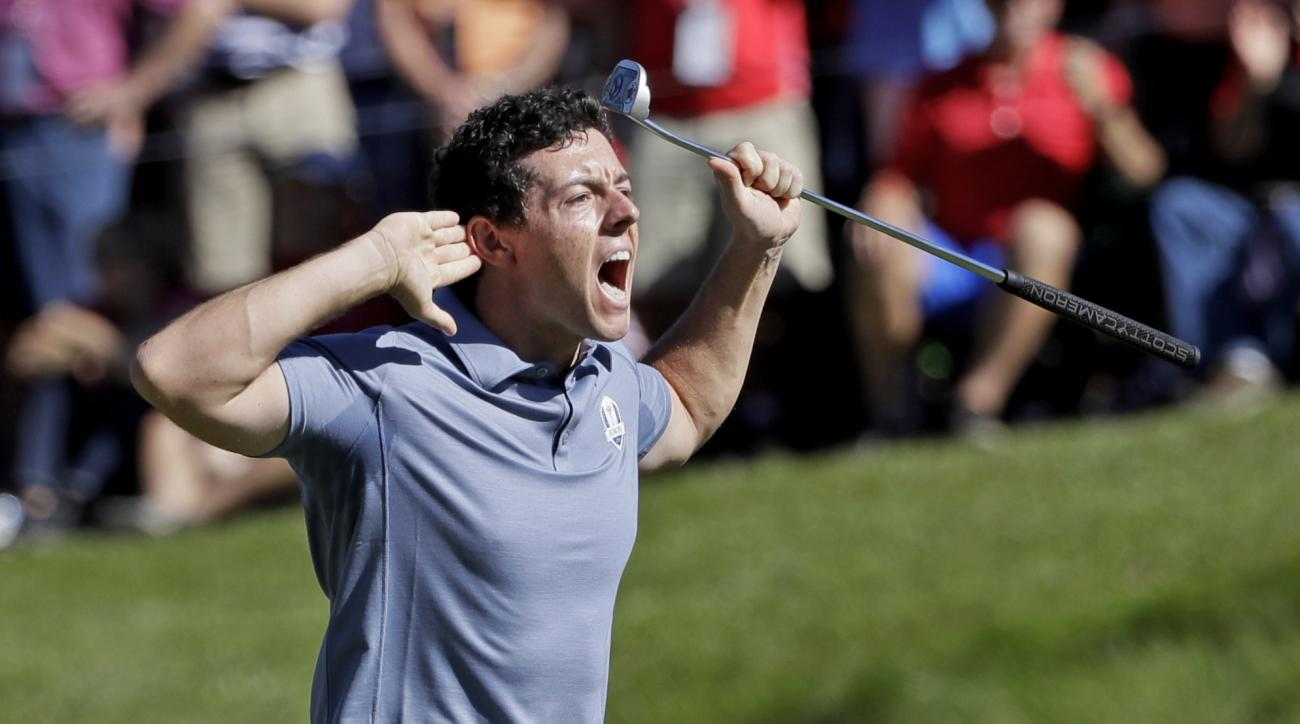 Europes Rory McIlroy gestures to the crowd after making his putt on the eighth hole during a singles match at the Ryder Cup golf tournament Sunday, Oct. 2, 2016, at Hazeltine National Golf Club in Chaska, Minn. (AP Photo/David J. Phillip)