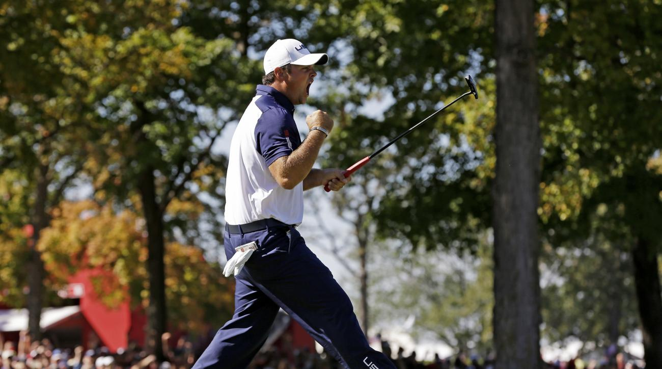 United States Patrick Reed reacts after winning the 12th hole during a singles match at the Ryder Cup golf tournament Sunday, Oct. 2, 2016, at Hazeltine National Golf Club in Chaska, Minn. (AP Photo/David J. Phillip)