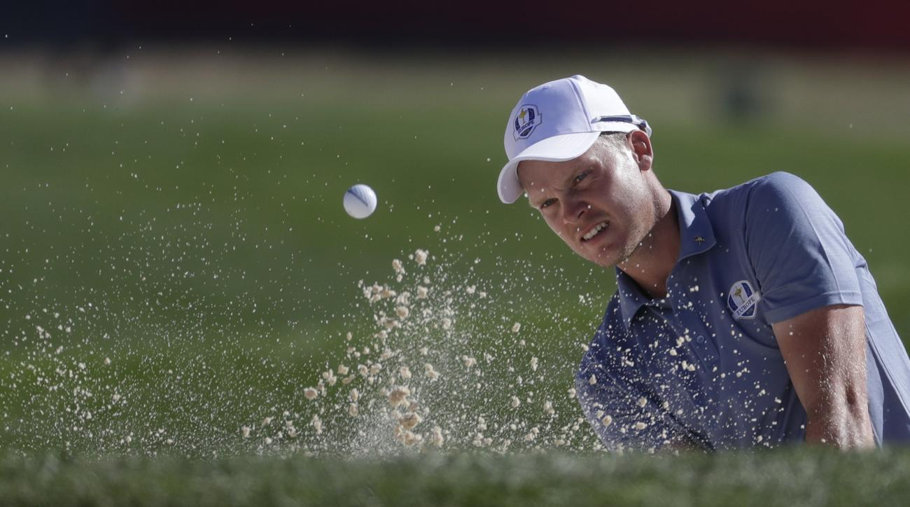 Europes Danny Willett hits from a bunker on the ninth hole during a singles match at the Ryder Cup golf tournament Sunday, Oct. 2, 2016, at Hazeltine National Golf Club in Chaska, Minn. (AP Photo/Chris Carlson)
