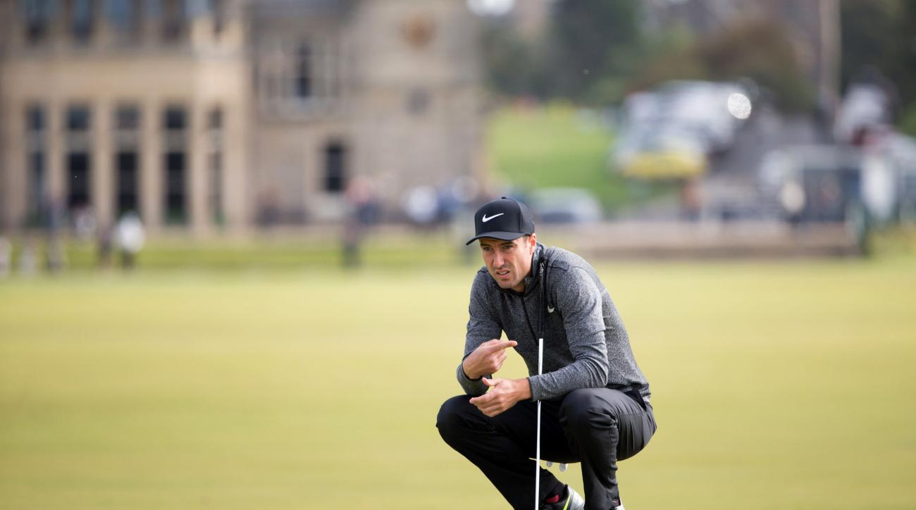 England's Ross Fisher lines up a putt on the 1st green during day four of the Alfred Dunhill Links Championship at St Andrews, Scotland, Sunday Oct. 9, 2016. (Kenny Smith/PA via AP) UNITED KINGDOM OUT NO SALES NO ARCHIVE