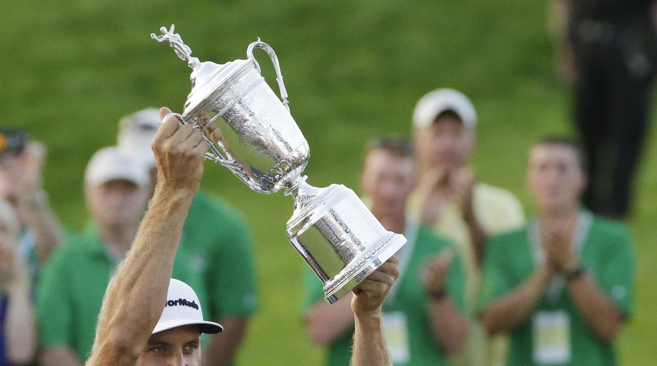 FILE - In this June 19, 2016, file photo, Dustin Johnson holds the trophy as Jack Nicklaus looks on after winning the U.S. Open golf championship at Oakmont Country Club, in Oakmont, Pa. Johnson made it a clean sweep of the tour's biggest honors that are