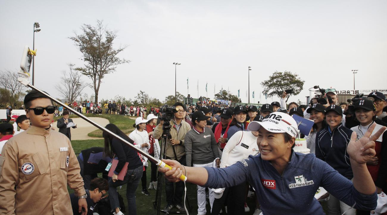 Se Ri Pak of South Korea takes a selfie picture during her retirement ceremony at the LPGA KEB HanaBank Championship 2016 tournament at Sky72 Golf Club in Incheon, South Korea, Thursday, Oct. 13, 2016. Pak ended her Hall of Fame career Thursday in front o