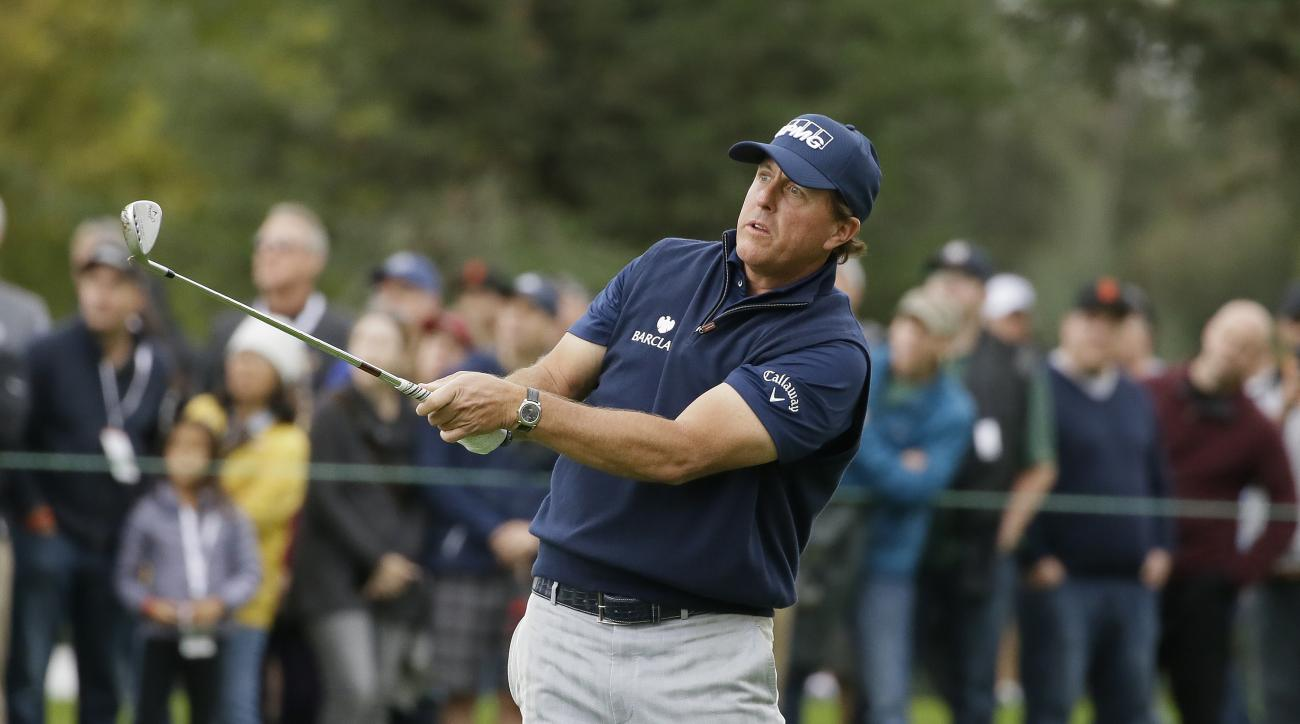 Phil Mickelson follows his approach shot from the fairway to the first green of the Silverado Resort North Course during the third round of the Safeway Open PGA golf tournament, Saturday, Oct. 15, 2016, in Napa, Calif. (AP Photo/Eric Risberg)