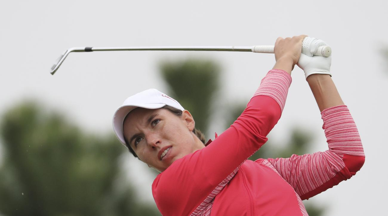 Carlota Ciganda of Spain watches her shot on the third hole during the final round of the LPGA KEB HanaBank Championship at Sky72 Golf Club in Incheon, South Korea, Sunday, Oct. 16, 2016. (AP Photo/Lee Jin-man)