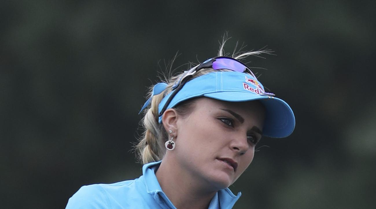 Lexi Thompson of the United States watches her shot on the second hole during the final round of the LPGA KEB HanaBank Championship at Sky72 Golf Club in Incheon, South Korea, Sunday, Oct. 16, 2016. (AP Photo/Lee Jin-man)