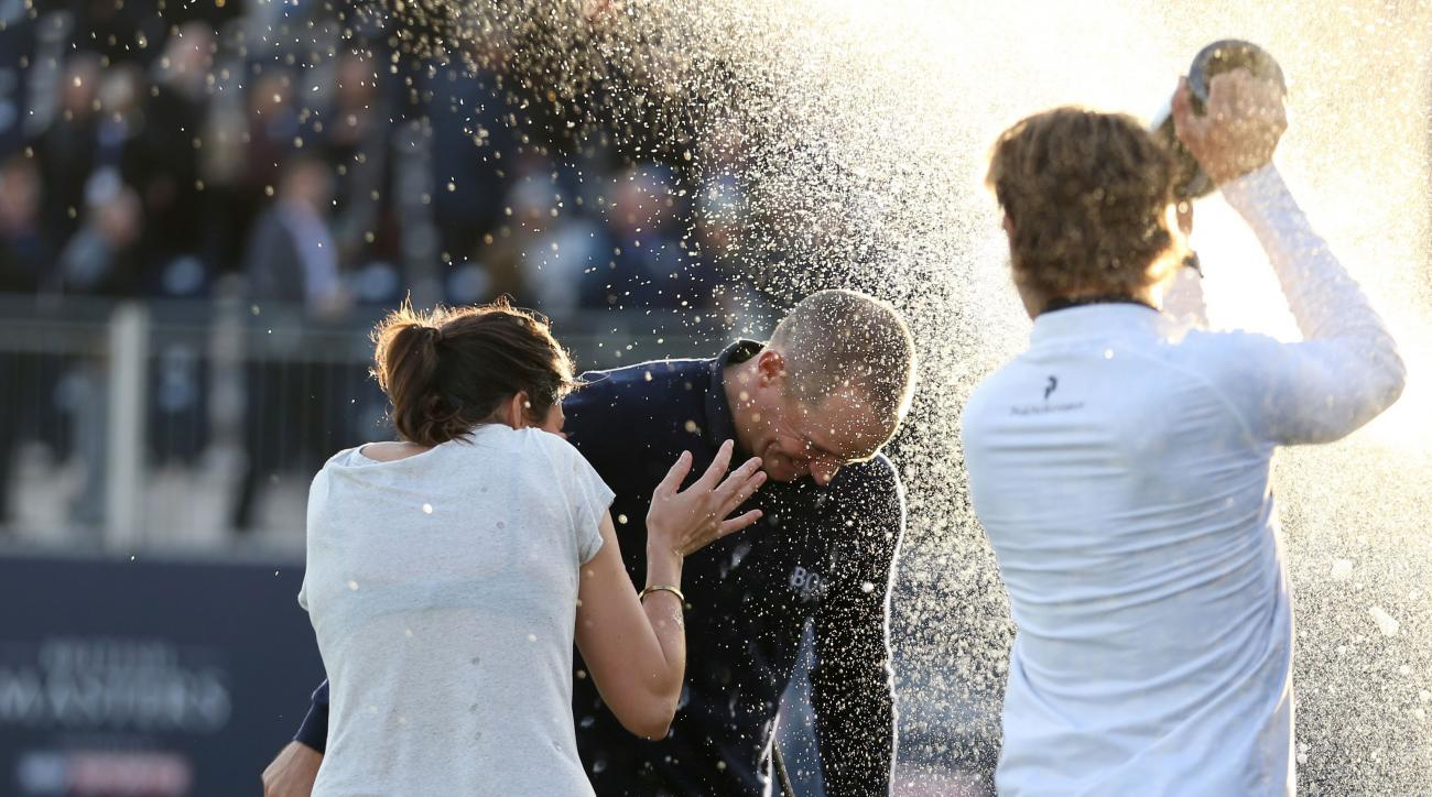 Sweden's Alex Noren is doused during celebrations after winning The British Masters golf tournament at The Grove, Chandler's Cross, England, Sunday Oct. 16, 2016.  (Steven Paston / PA via AP)