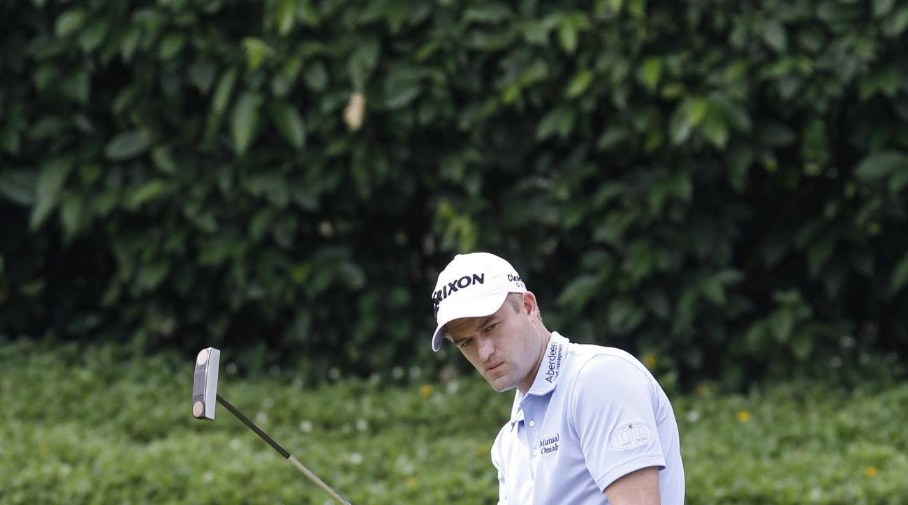 Russell Knox of Scotland reacts after missing a bridge on the first green during the final round of the CIMB Classic golf tournament at Tournament Players Club (TPC) in Kuala Lumpur, Malaysia, Sunday, Oct. 23, 2016. (AP Photo/Joshua Paul)