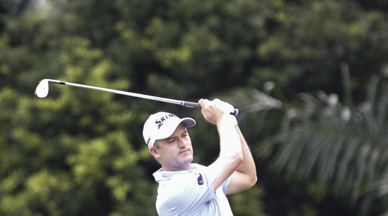 Russell Knox of Scotland follows his shot on the first hole during the final round of the CIMB Classic golf tournament at Tournament Players Club (TPC) in Kuala Lumpur, Malaysia, Sunday, Oct. 23, 2016. (AP Photo/Joshua Paul)