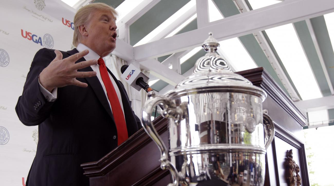 Donald Trump gestures during a news conference at Trump National in Bedminster, N.J., Thursday, May 3, 2012. The 65-year-old real estate mogul, TV personality and casino owner is going to be the host for the U.S. Women's Open in 2017. At right foreground