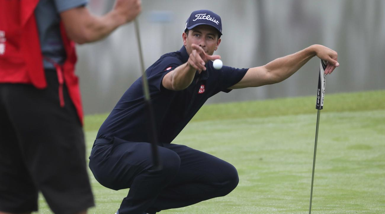 Adam Scott of Australia toss the ball to his caddie during the WGC-HSBC Champions golf tournament at the Sheshan International Golf Club in Shanghai, China, Thursday, Oct. 27, 2016. (AP Photo/Ng Han Guan)