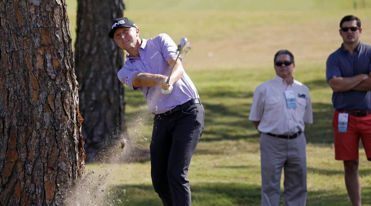 Fans watch Mackenzie Hughes, of Canada, hit from out of bounds on the No. 18 fairway on the first day of the Sanderson Farms Championship in Jackson, Miss., Thursday, Oct. 27, 2016. (AP Photo/Rogelio V. Solis)