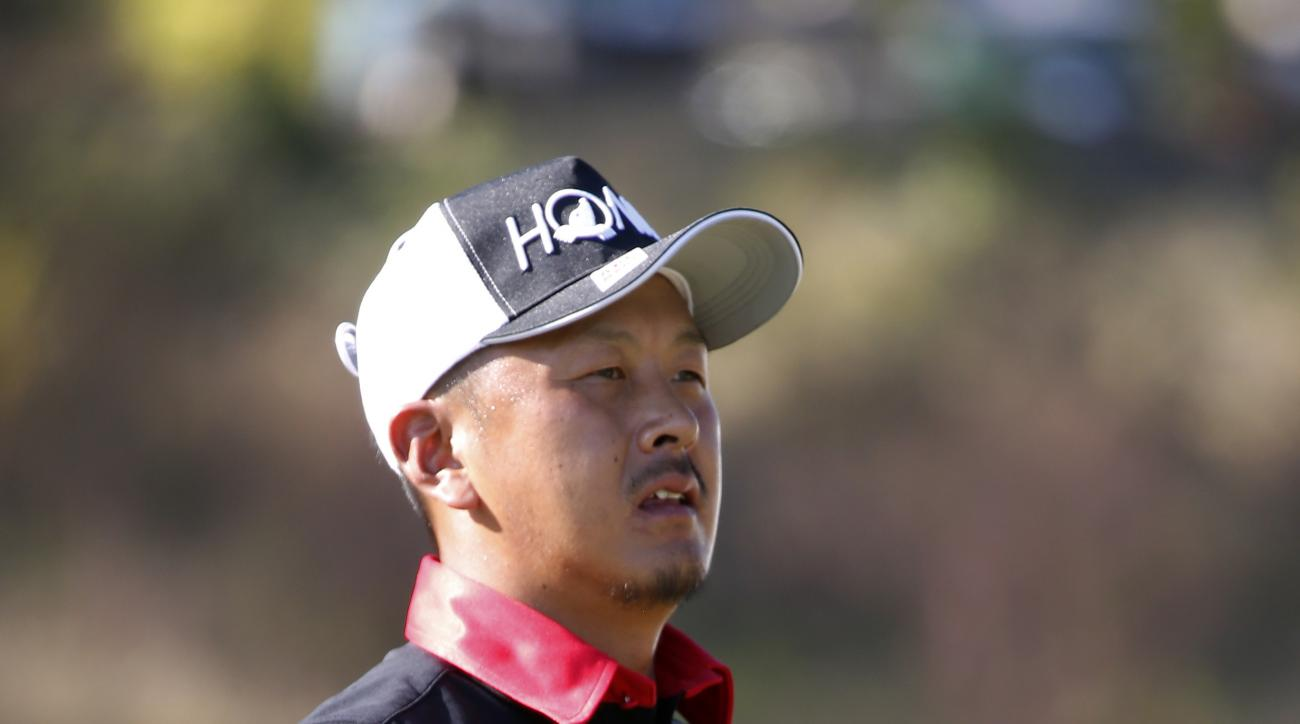 Hiroshi Iwata, of Japan, looks down the tenth fairway during the second round of the Sanderson Farms Championship golf tournament Friday, Oct. 28, 2016, in Jackson, Miss. (AP Photo/Rogelio V. Solis)