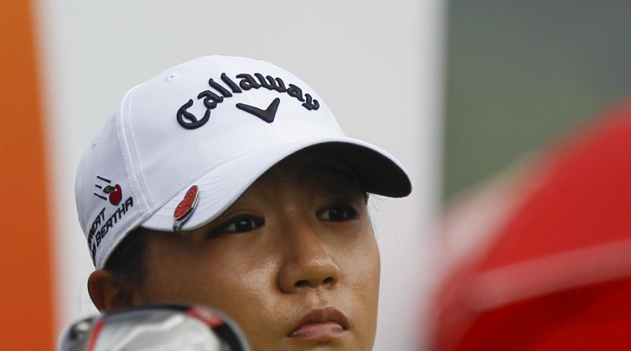 Lydia Ko of New Zealand follows her shot on the 10th hole during the final round of the LPGA golf tournament at Tournament Players Club (TPC) in Kuala Lumpur, Malaysia, Sunday, Oct. 30, 2016. (AP Photo/Joshua Paul)
