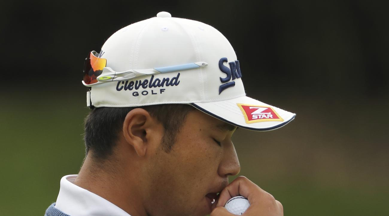 Japan's Hideki Matsuyama holds a golf ball to this mouth during the 2016 WGC-HSBC Champions golf tournament at the Sheshan International Golf Club in Shanghai, China, Sunday, Oct. 30, 2016. (AP Photo/Ng Han Guan)