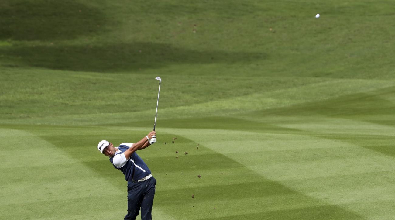 Japan's Hideki Matsuyama hits from the fairway during the 2016 WGC-HSBC Champions golf tournament at the Sheshan International Golf Club in Shanghai, China, Sunday, Oct. 30, 2016. (AP Photo/Ng Han Guan)