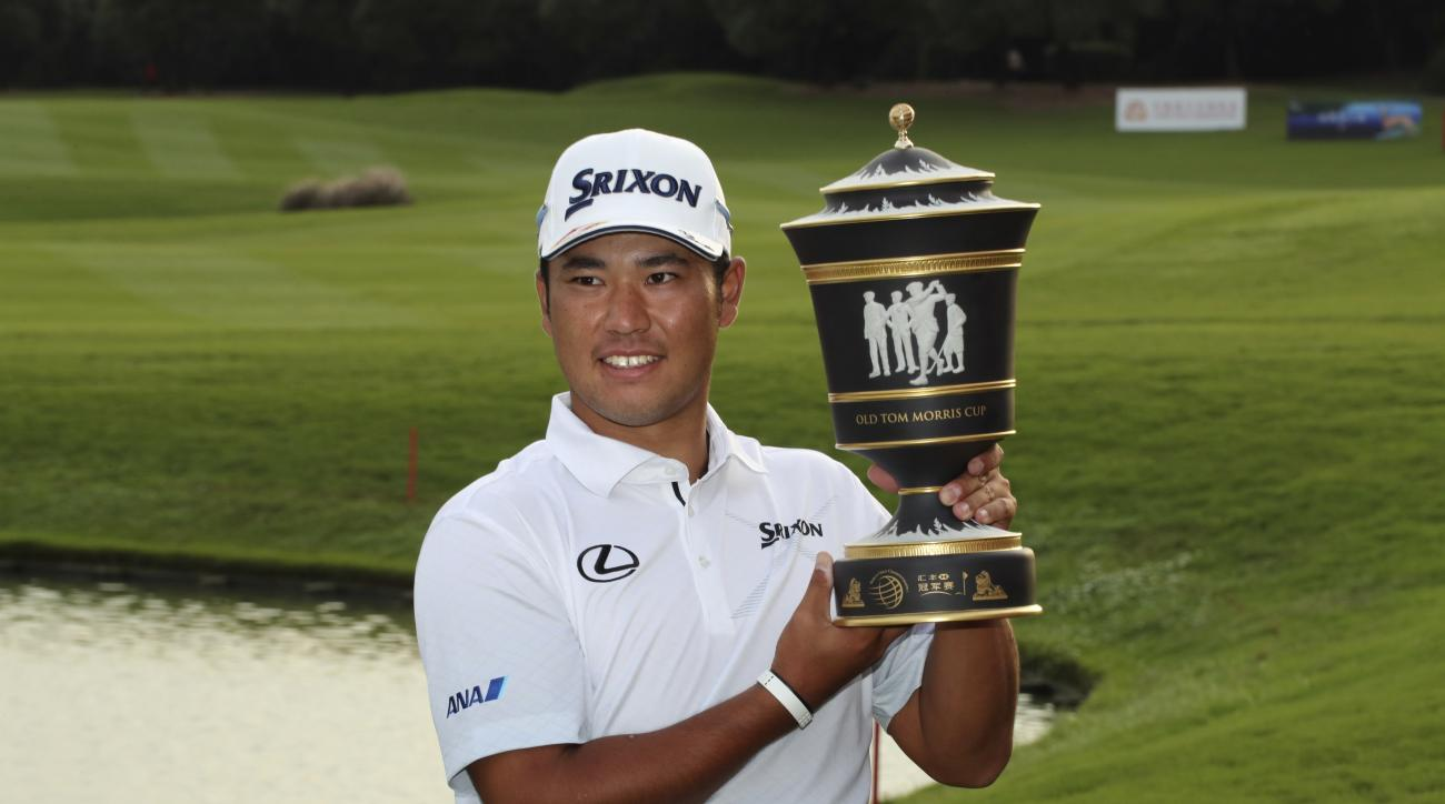 Japan's Hideki Matsuyama poses with the trophy after winning the 2016 WGC-HSBC Champions golf tournament at the Sheshan International Golf Club in Shanghai, China, Sunday, Oct. 30, 2016. (AP Photo/Ng Han Guan)