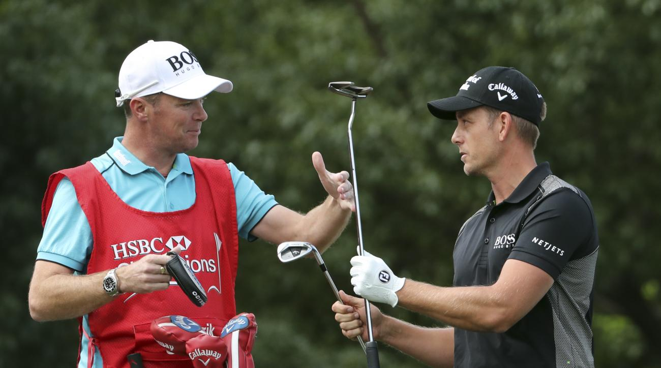 Henrick Stenson of Sweden switch clubs during the 2016 WGC-HSBC Champions golf tournament at the Sheshan International Golf Club in Shanghai, China, Sunday, Oct. 30, 2016. (AP Photo/Ng Han Guan)