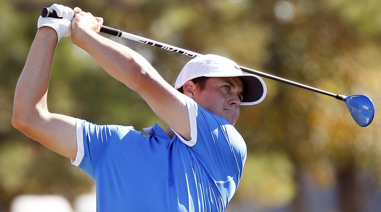 Cody Gribble watches his drive on the ninth tee box during the final round of the Sanderson Farms Championship golf tournament in Jackson, Miss., Sunday, Oct. 30, 2016. (AP Photo/Rogelio V. Solis)