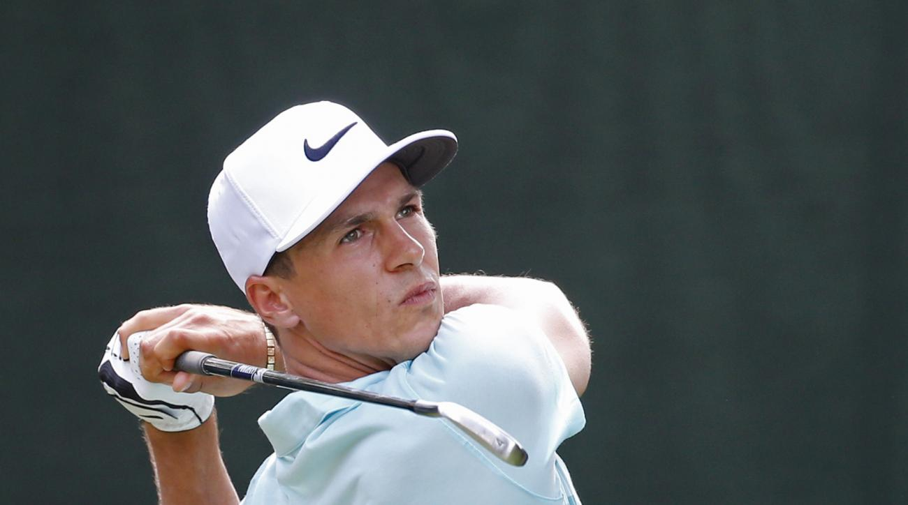 Thorbjorn Olesen, of Denmark, watches his tee shot on the 16th hole during the first round of the PGA Championship golf tournament at Baltusrol Golf Club in Springfield, N.J., Thursday, July 28, 2016. (AP Photo/Mike Groll)