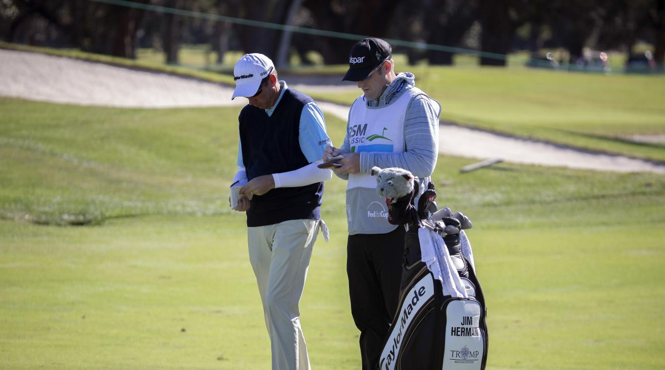 Jim Herman, right, and his caddie plan his shot on the first fairway during the final round at the RSM Classic golf tournament, Sunday, Nov. 20, 2016, in St. Simons Island, Ga. (AP Photo/Stephen B. Morton)
