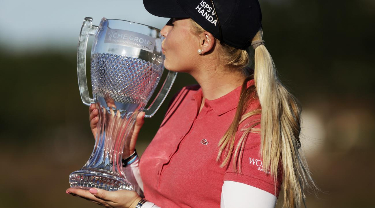 Charley Hull, of England, kisses her trophy after winning the CME Group Tour Championship golf tournament during the award ceremony after the tournament in Naples, Fla., Sunday, Nov. 20, 2016. (Dorothy Edwards/Naples Daily News via AP)