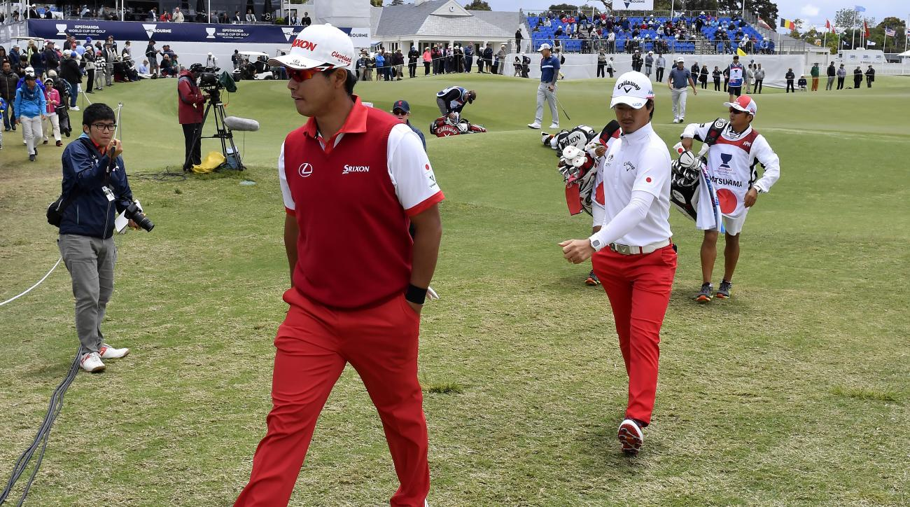 Japan's Hideki Matsuyama, left, walks with teammate Ryo Ishikawa to the eighth tee during their match at the World Cup of Golf at Kingston Heath in Melbourne, Australia, Thursday, Nov. 24, 2016. (AP Photo/Andrew Brownbill)