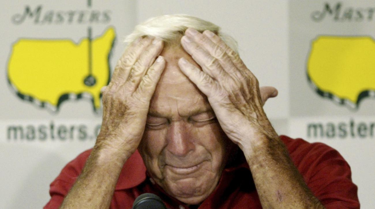 FILE - In this April 9, 2004, file photo, Arnold Palmer reacting during his press conference after playing his final round of Masters competition at the 2004 Masters golf tournament at the Augusta National Golf Club in Augusta, Ga. Tiger Woods turns 41 at