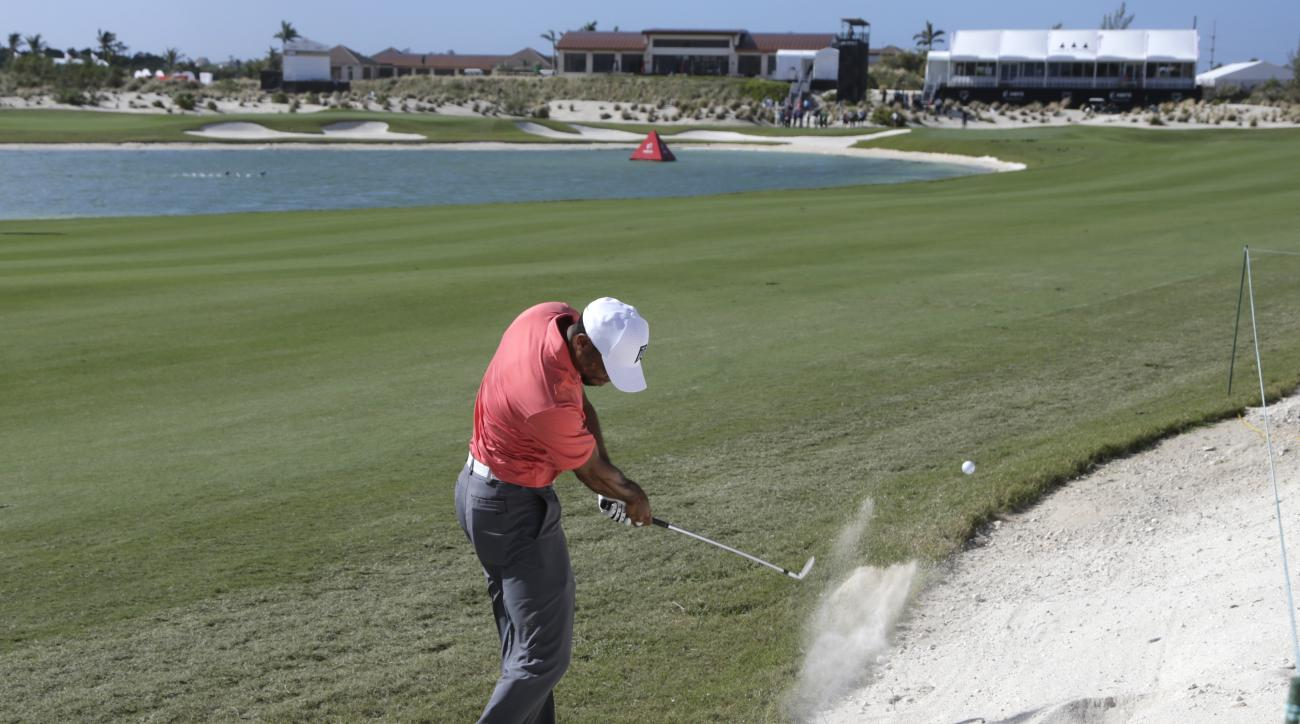 Tiger Woods hits from a bunker on the 18th hole during the Pro-Am at the Hero World Challenge golf tournament, Wednesday, Nov. 30, 2016, in Nassau, Bahamas. (AP Photo/Lynne Sladky)