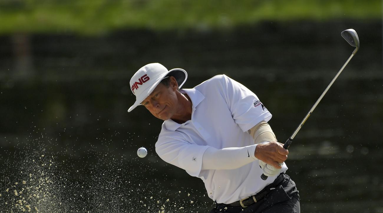 Jim Carter hits out of a bunker on the third hole during the second round of the PowerShares QQQ Championship golf tournament, Saturday, Oct. 29, 2016, at Sherwood Country Club in Thousand Oaks, Calif. (AP Photo/Mark J. Terrill)