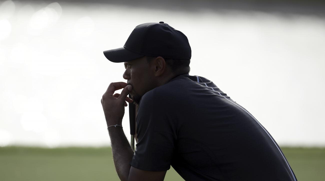 Tiger Woods waits to hit on the 17th hole during the first round at the Hero World Challenge golf tournament, Thursday, Dec. 1, 2016, in Nassau, Bahamas. Woods is one-over-par for the round. (AP Photo/Lynne Sladky)